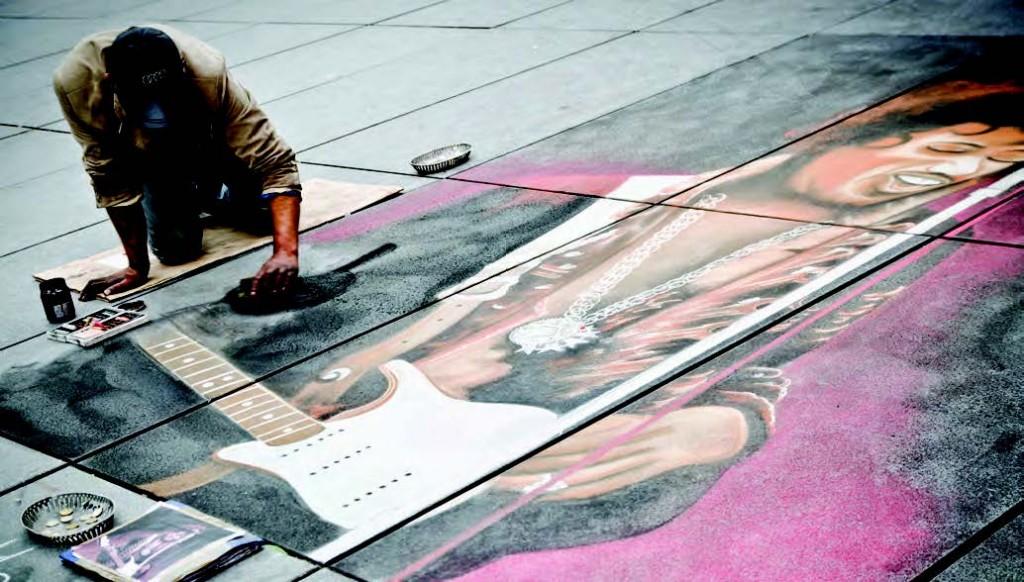 Artista pintando en la Place Stravinski.